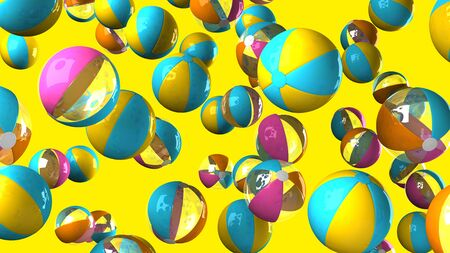 Colorful beach balls on yellow background