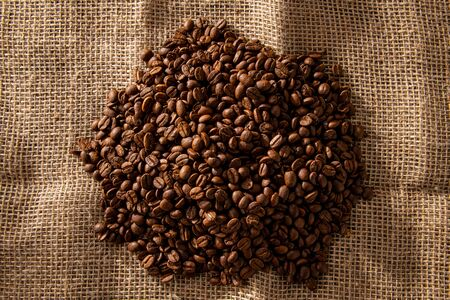 Coffee beans on jute bag 写真素材
