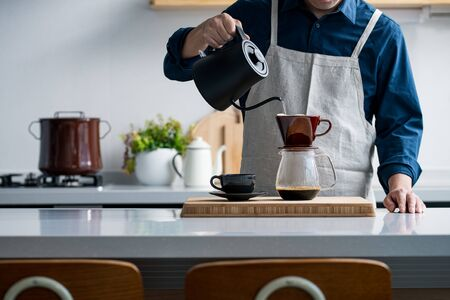 Making coffee in the kitchen