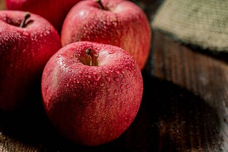 Apples on wood background 写真素材