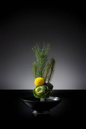 Japans New Year Flower Arrangement on Black Background.