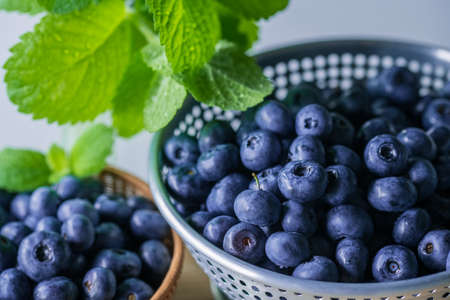 Fresh ripe blueberries in colander.