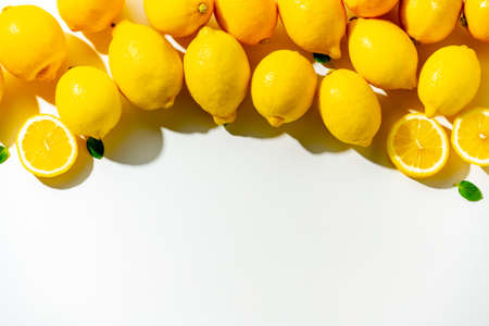 Lemons on white background. Flesh lemons on white text space.
