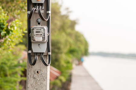electricity meter: Electricity meter installed in the atmosphere of the waterfront in thailand Stock Photo