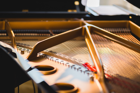 open piano mechanism with hammers and strings
