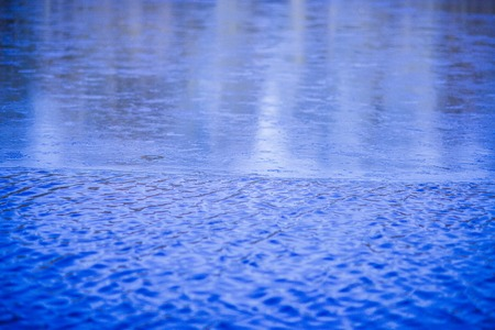 borderline: borderline of partially frozen lake with ice and water Stock Photo