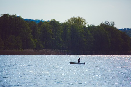 angler: angler in small boat on mueggelsee Lake near berlin Germany Stock Photo