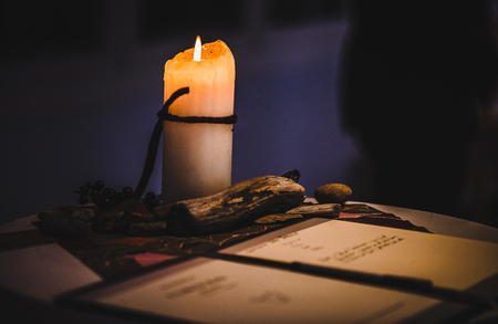 Reading a letter by candle light from old days Stock Photo
