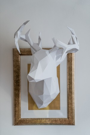 paper sculpture: origami paper model of white stag head vault sculpture