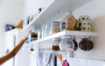 Various food ingredients and utensils on kitchen shelves selective focus Zdjęcie Seryjne