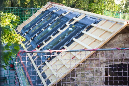 2x4 wood: A new home under construction with roof floor Stock Photo