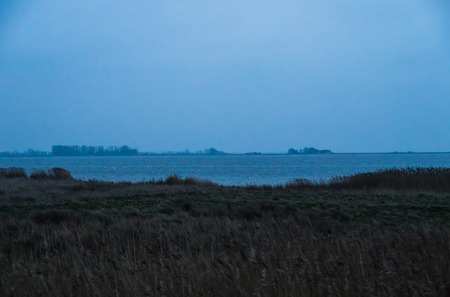 groyne: Misty Groyne landscape at foggy turquoise cyan sea Stock Photo