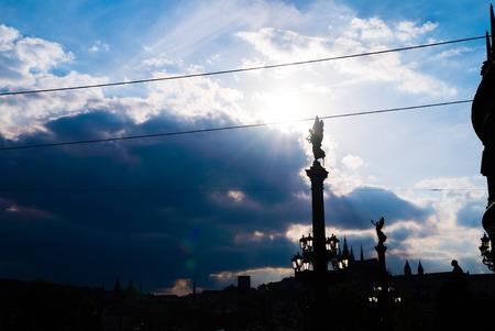 czech culture: Statues near Charles Bridge with impressive dramatic sky and clouds, Prague, Czech Republic