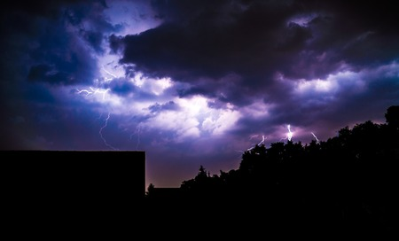 lightnings: clouds and thunder lightnings and storm at night Stock Photo