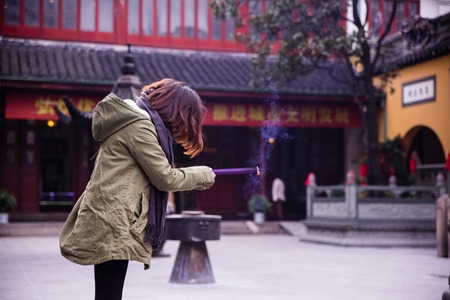 jade buddha temple: SHANGHAI Devotees light up joss-sticks to pray at the Jade Buddha Temple in Shanghai, China. Buddhism is enjoying a revival in modern liberal China.