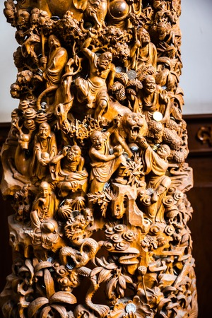 finely: Finely carved wooden buddha role at chinese temple. Detail of Buddhas story in Buddhism religion.