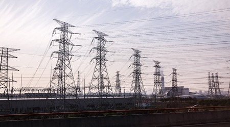 power cables: Power Towers with electricity voltage cables before blue sky Stock Photo