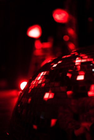 mirrorball: Red shining discoball with reflecting lights, mirrorball in motion