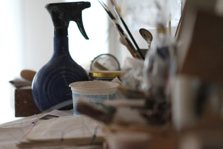 sculpting: Set of dirty art and craft sculpting tools on wooden table in pottery workshop Stock Photo