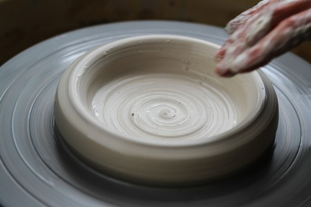 potters wheel: Closeup on hands of potter on potters wheel