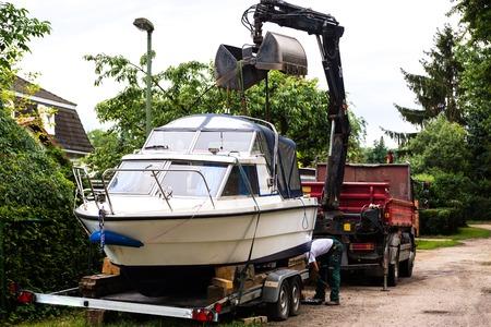 oversize load: semi boat loading for transport on transporter van truck
