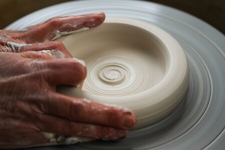 Hands of a potter, creating white porcelain Stockfoto