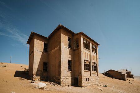 abandoned big house on a high desert plain