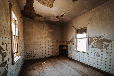 old ruined abandoned kitchen room without funiture and equipment before renovation - kitchen restoration concept