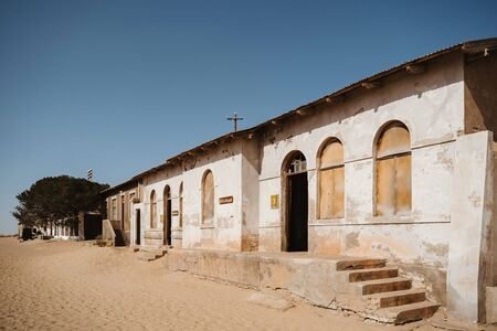 home ruins in the African desert sunk in sand
