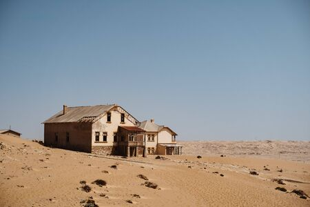 wideangle view of desert ghost town of Kolmanskop Luderitz in Namibia 免版税图像