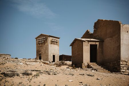 symbolic photo for decay, death and time passing when desert sand enters ruined building in Kolmanskop, Namibia, Africa