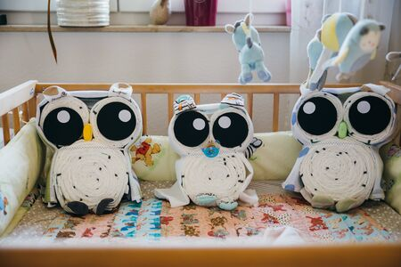 design of children bed arranged with stuffed animal