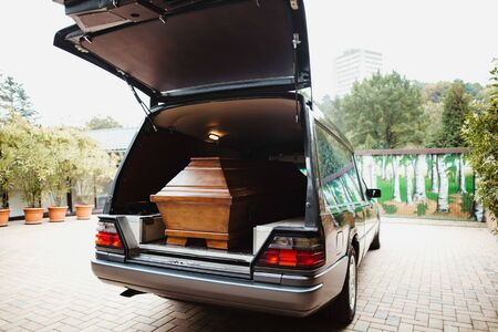 photo of a coffin car at a funeral Stock Photo