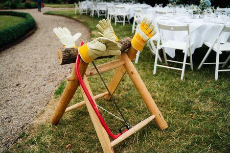 wedding a wooden sawhorse in the garden Фото со стока
