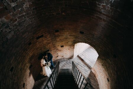 a married couple standing on stairs