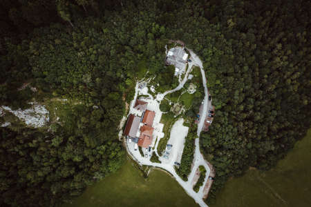 aerial photo of a residential house in forest