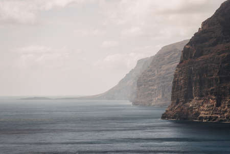 Photo of the cliffs at the Los Gigantes coast in the southern region of the island of Tenerife (Canary Islands, Europe)