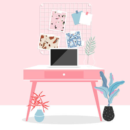 Workspace at home. Pink room interior. Working from home during the isolation. Laptop on the table. Pink working desk, memory board on the wall and plants. Modern living and trendy interior design.