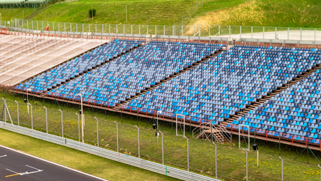 Budapest, Hungary - AUG 15, 2017: Blue seats of the grandstand next to the finish line of Hungaroring. Its a motorsport race track in Hungary where the Formula One Hungarian Grand Prix is ??held.