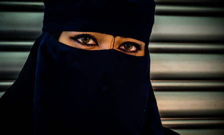 unrecognisable person: Model of Young Muslim woman with black veil Stock Photo