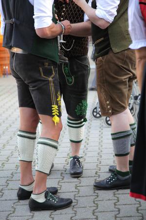 lederhosen: three bavarians in lederhosen Stock Photo