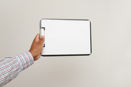 blotter: blotter held by a man. Paper is jammed and empty.