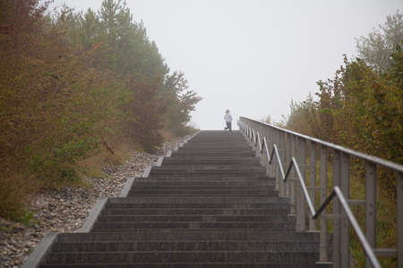 happieness: stairs at a hill in fog.
