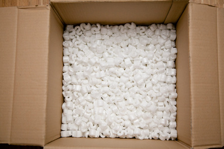 moving box: white object in moving box. Material good for sensitive objects.