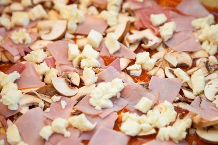 baking tray: Pizza raw in a baking tray in the kitchen. Stock Photo