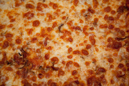baking tray: Pizza in a baking tray on a black table.