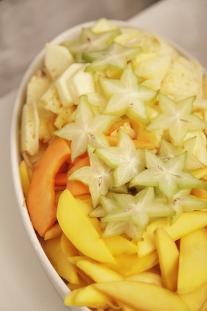 phisalis: star fruit, mango, honeydew melon sliced in a white casserolle