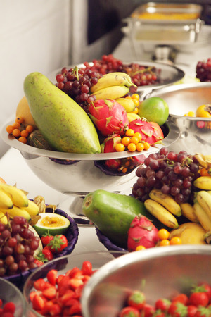 phisalis: buffet with mixed fruit at a party or event.
