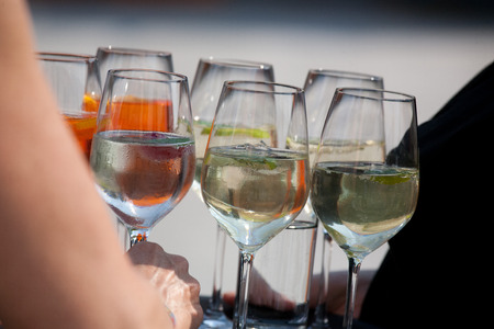 party tray: Aperitif Glasses on a tray at an event, party or congress. Stock Photo