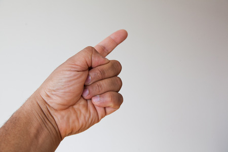 man pointing up: hand of a man pointing up. Stock Photo